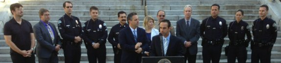 L.A. City Councilmember Mitch Englander (center, at podium) touts the city's efforts to stem hit-and-run crimes at this morning's press conference. Photo: Joe Linton/Streetsblog L.A.
