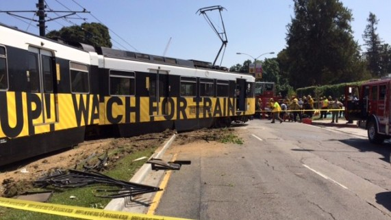 Eyes on the Street: Metro's Expo Line collided with a car and derailed last Satuday near USC.  12 people injured, one critically. Photo via Metro.