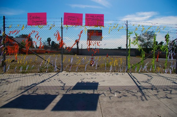 YouthBuild students contributed to an installation at a Metro-owned lot at 1st and Boyle protests the lack of a community process around the affordable housing project slated for the site. Sahra Sulaiman/Streetsblog L.A.