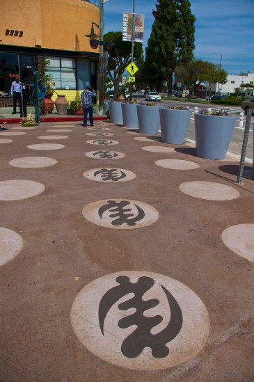 Some of the Adinkra symbols community members have been painting in the polka dots on the People St Plaza in Leimert Park. Sahra Sulaiman/Streetsblog L.A.