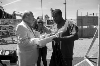 Gilbert shows the 1992 article to developer Eli Sasson and asks about jobs for the community. Sahra Sulaiman/Streetsblog L.A.