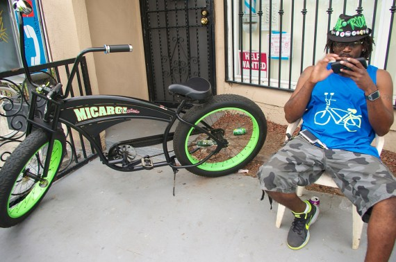 "Ervin ""EJ"" Bromell and his bike relax outside the new co-op space. Sahra Sulaiman/Streetsblog L.A."
