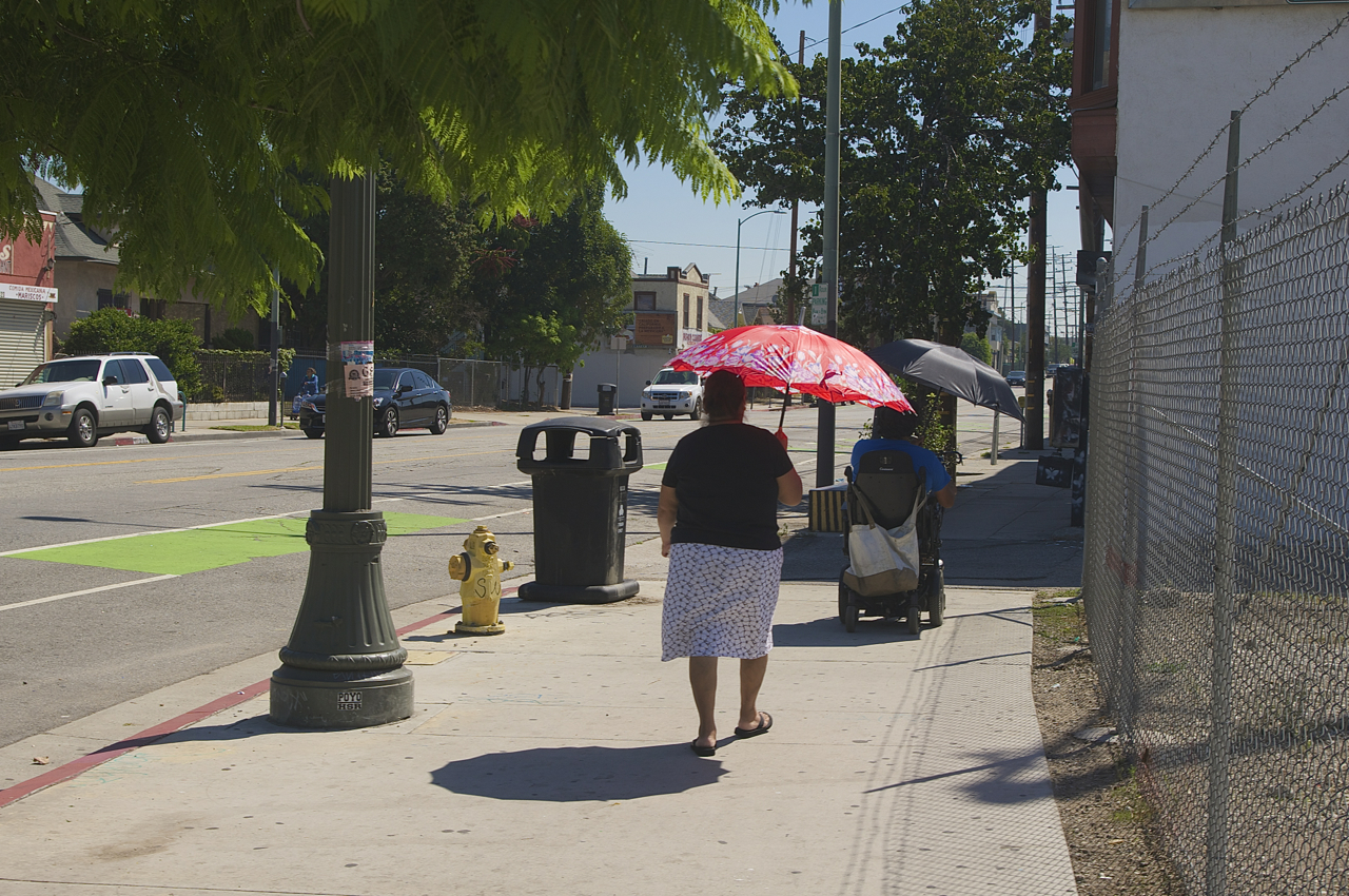 Umbrellas rule the day on a baking hot Saturday in Boyle Heights. Sahra Sulaiman/Streetsblog L.A.