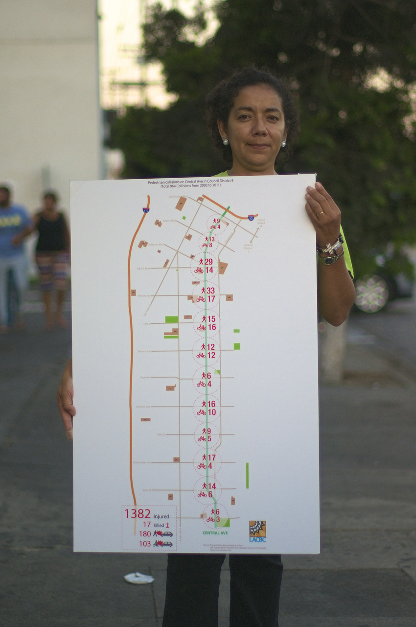 Araceli Alvarado holds a map of Central Ave. showing the number of collisions involving pedestrians and cyclists. Sahra Sulaiman/Streetsblog L.A.