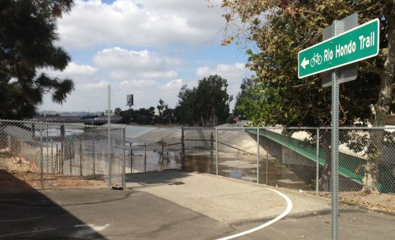 For years, the connection to the Rio Hondo bike/walk trail was fenced off. It's now open, and has directional signage to