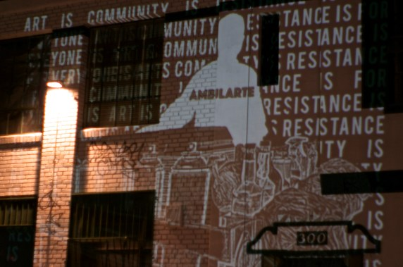 """""""Art is Community; Art is Resistance"""" is projected on the wall of Michele Maccarone's new gallery space on Mission Road in Boyle Heights. Sahra Sulaiman/Streetsblog L.A."""