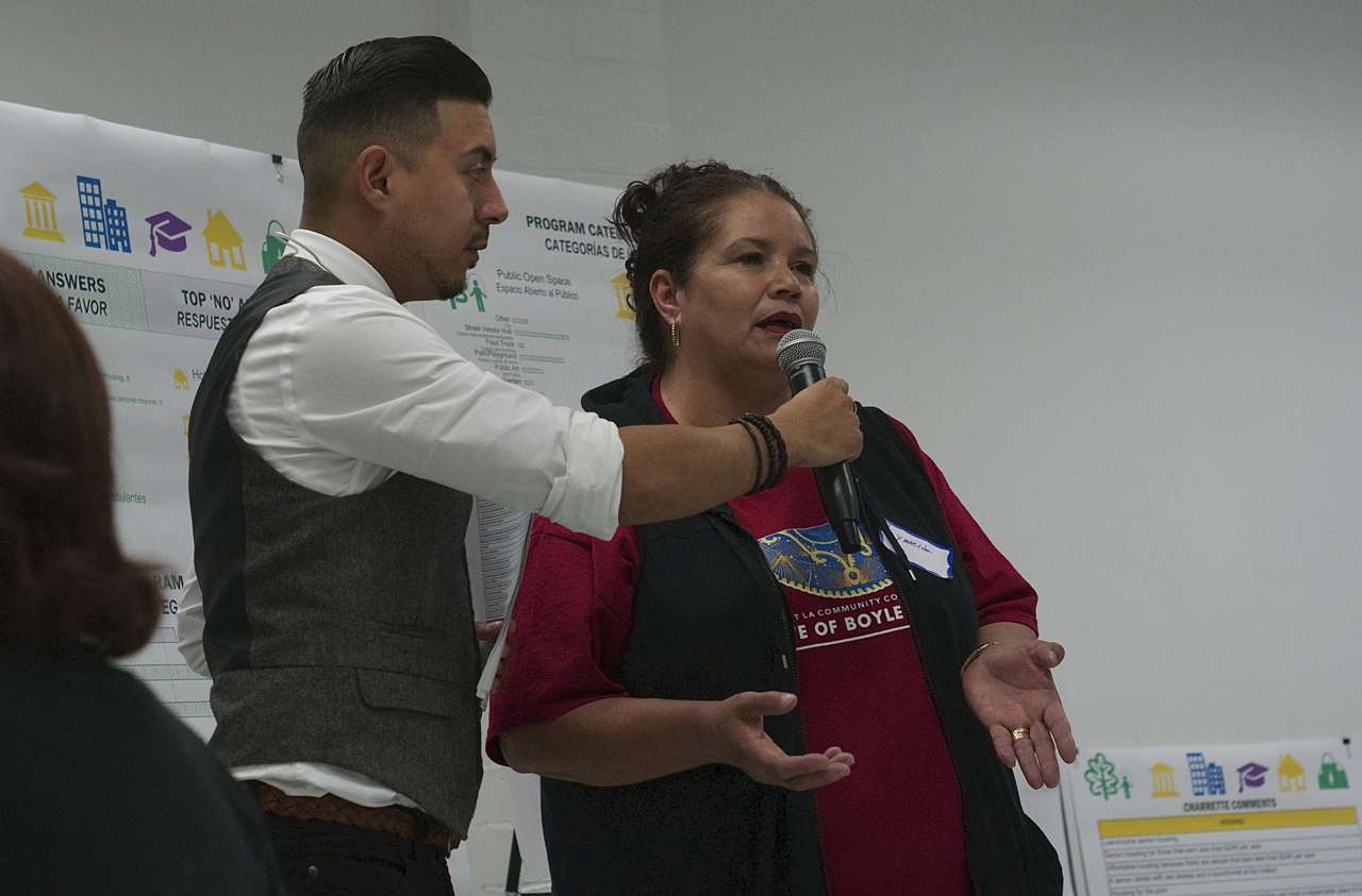 A woman reports her table's ideas back to larger group. Although many present were housing proponents, they were adamant that any development speak to the culture and multi-generational nature of the community. Sahra Sulaiman/Streetsblog L.A.