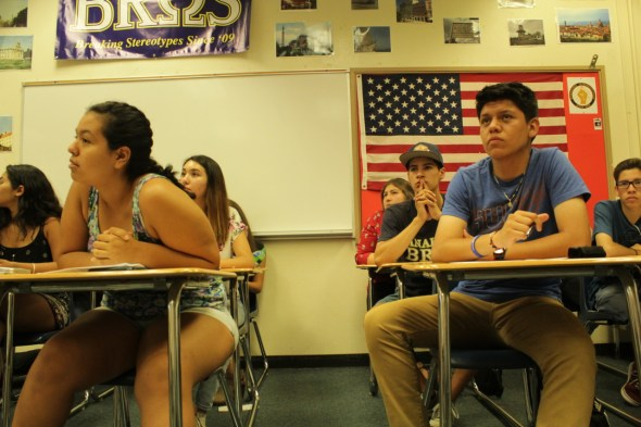 Seventeen-year-old Alma Perez , from left, and Sergio Nieto, 16 in blue shiirt, of Anaheim High School listen to a presentation from a representative of the Orange County Transportation Authority. Residents of Anaheim and Garden Grove are currently attending workshops to learn about how transportation goes from policy to reality.
