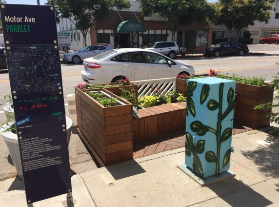 Parklets feature the People St pedestrian scale signage