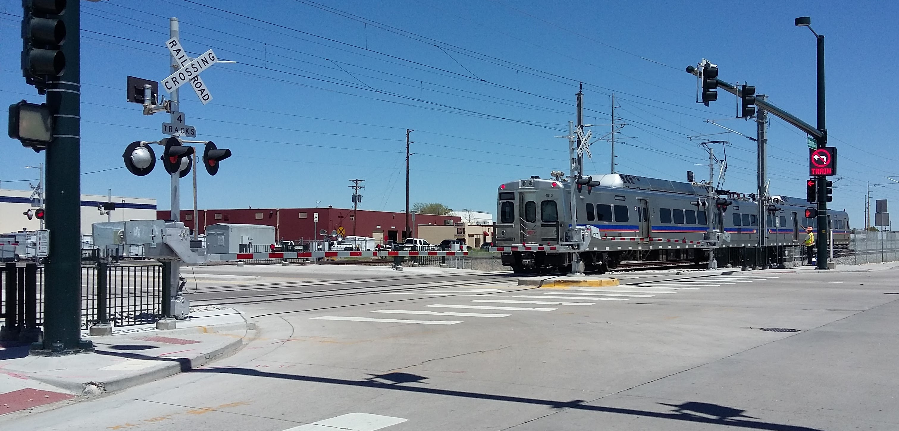 New Denver RTD electric-catenary heavy rail crossing at grade. Photo from Wikimedia Commons