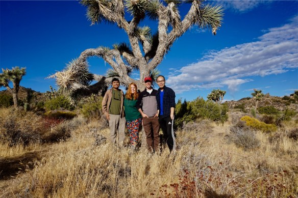 Mikhail, Cate, Jeremy, and Alby standing in front of a Joshua tree