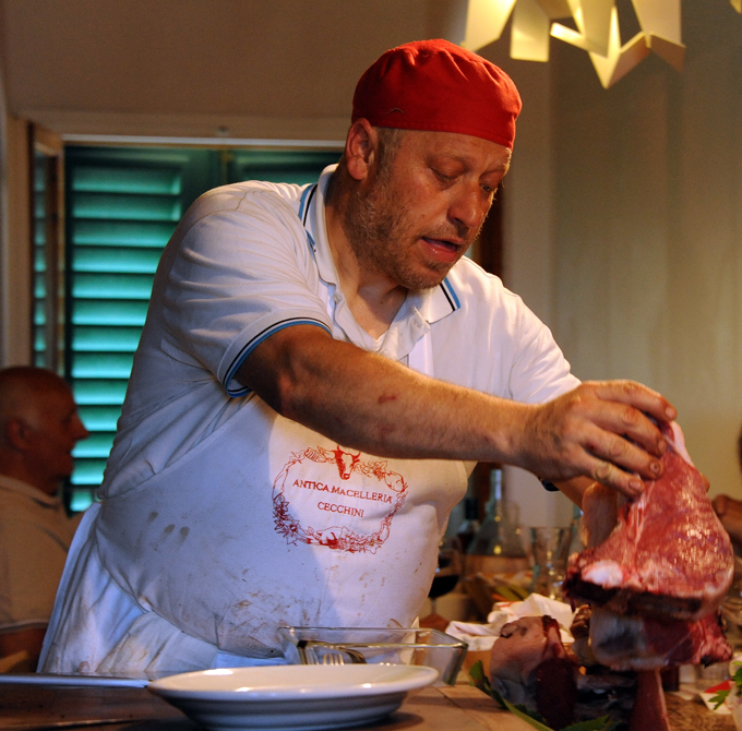 Dante, carefully preparing the beefsteak for grilling at Dario's famous Panzano  restaurant.