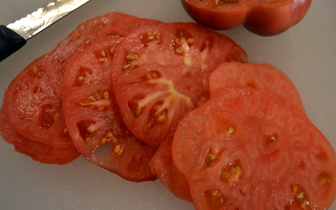 Sliced heirloom tomatoes for Bruschetta with Tomato, Mozzarella & Anchovy | labellasorella.com