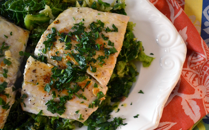 Garlic, anchovy, & savoy cabbage perfectly pair with pan roasted bass | labellasorella.com