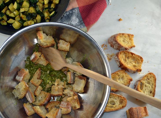 Tossing the toasted bread with pesto | labellasorella.com