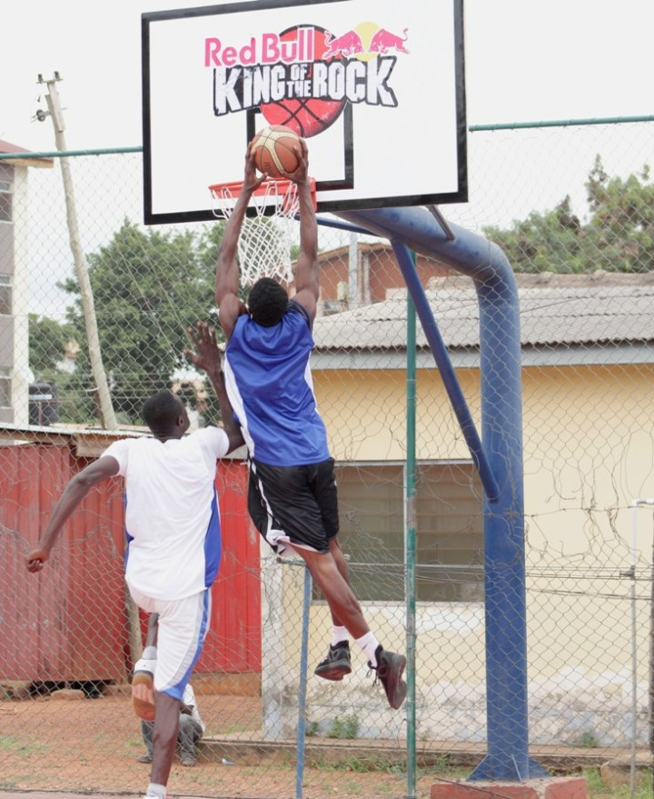accra-man-slam-dunking-basketball