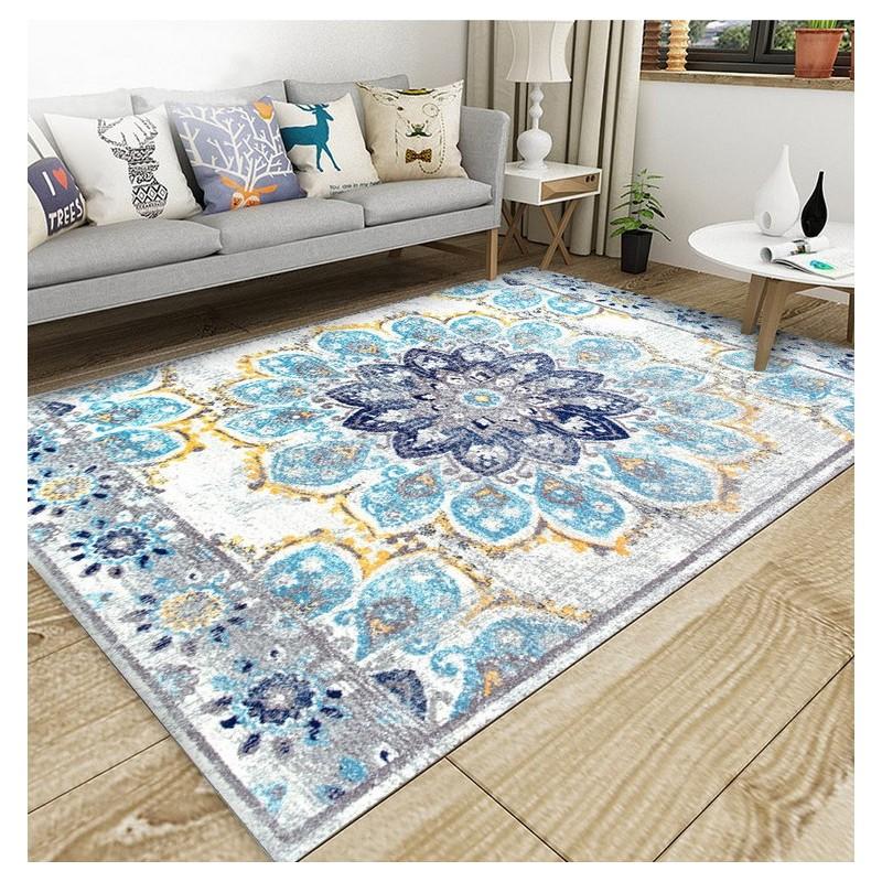 tapis artisanal traditionnel en pure laine noue a la main motif tricolore fleur bleu fond gris claire trait jaune atelier wybo