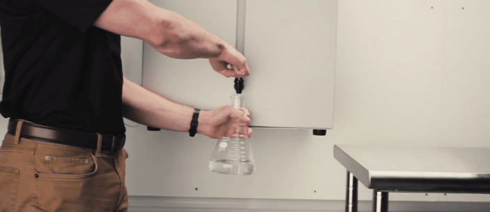 Filling Beaker with distilled water from water purifier