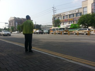 A man waits for the bus.