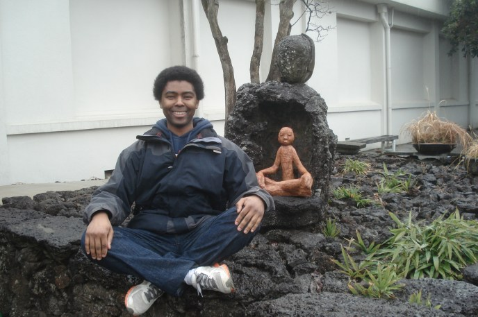 Me (smiling) next to the meditating statue