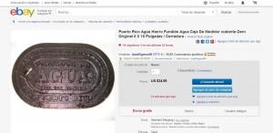 "Foto de pantalla de la oferta de la tapa de contador de la AAA en el portal de ""eBay""."