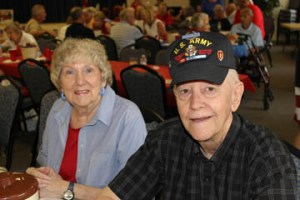 Sally and Tom Smith, a Korean War veteran, enjoy themselves at the party.