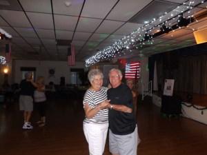 Jean Schreiber and George Meekins take a stroll on the dance floor.