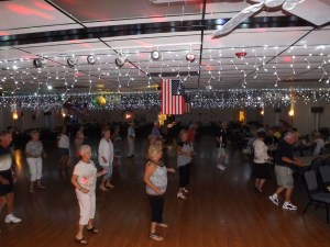 La Casa line dancers take over the floor to the music of Boot Scottin Boogie.
