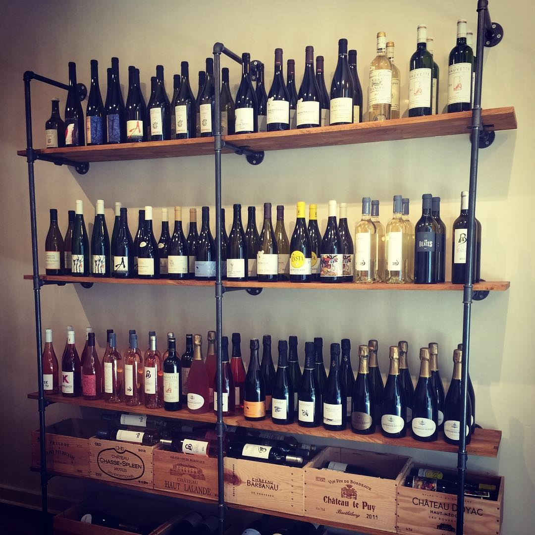 Cave à Vin - Our Wine display for White rosé and sparkling wines naturally vinefied and organically or biodynamically grown, on hand built cast iron and oak shelves with wooden wine boxes as display