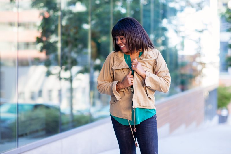 Anorak jacket worn with distressed denim.