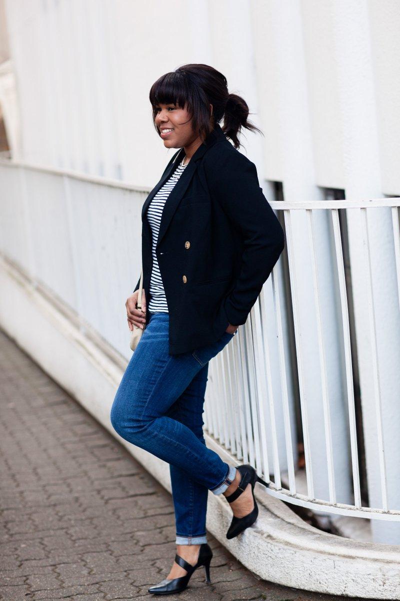 Prep style: black blazer, stripe tee, and jeans.