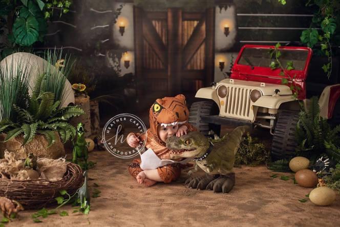 Jurassic Park themed cake smash photo backdrop