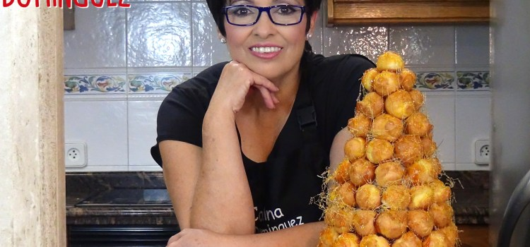 Tarta de profiteroles o Croquembouche rellenos de crema pastelera