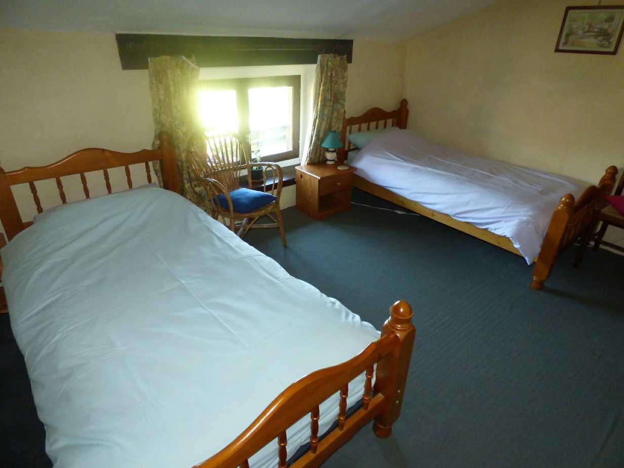 Sartre's twin bed bedroom