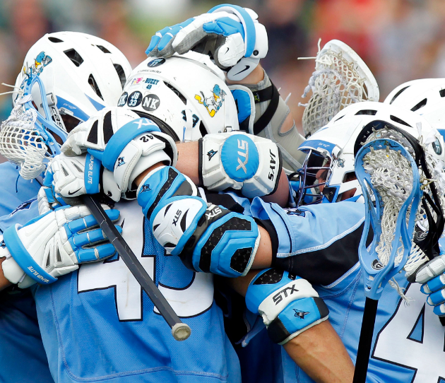 March 24, 2012; Charlottesville, VA, USA; John Hopkins Blue Jays attack Wells Stanwick (42) celebrates with teammates after scoring a goal against the Virginia Cavaliers in the second half at Klockner Stadium. The Blue Jays won 11-10 in overtime. Mandatory Credit: Geoff Burke-USA TODAY Sports