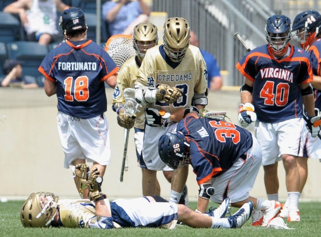 May 20, 2012; Chester, PA USA; Notre Dame Fighting Irish attack Ryan Foley (15) lies on the field after a hit by Virginia Cavaliers midfielder Bobby Hill (36) during the second half of the NCAA Division I Men's Lacrosse Quarterfinals at PPL Park. The Fighting Irish won 12-10. Mandatory Credit: Eric Hartline-USA TODAY Sports