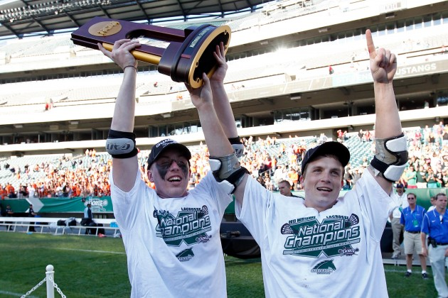 May 26, 2013; Philadelphia, PA, USA; Stevenson Mustangs defenseman Kyle Holechek (left) and midfielder Peter Green (12) celebrate after defeating the RIT Tigers 16-14 at the 2013 NCAA Division III Men's Lacrosse championship game at Lincoln Financial Field. Mandatory Credit: Debby Wong-USA TODAY Sports