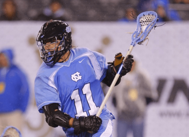 Apr 1, 2012; East Rutherford, NJ, USA; North Carolina Tar Heels attack Joey Sankey (11) during the third quarter against the John Hopkins Blue Jays at the Big City Classic at MetLife Stadium. North Carolina Tar Heels defeat the John Hopkins Blue Jays 13-9. Mandatory Credit: Jim O'Connor-USA TODAY Sports