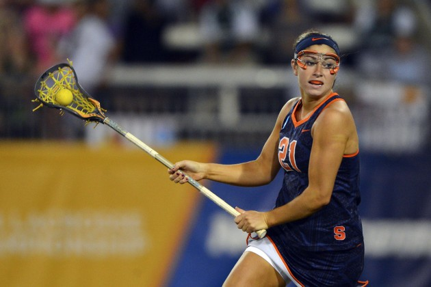 May 25, 2014; Towson, MD, USA; Syracuse attack Kayla Treanor (21) drives towards the net during the the first half against Maryland during the women's college lacrosse championshipat Johnny Unitas Stadium. Mandatory Credit: Tommy Gilligan-USA TODAY Sports