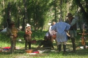 Mountain men gather 'round to study handmade trade goods