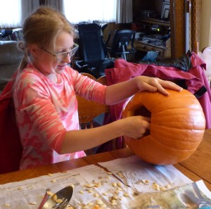 Siobhan hard at work on her pumpkin
