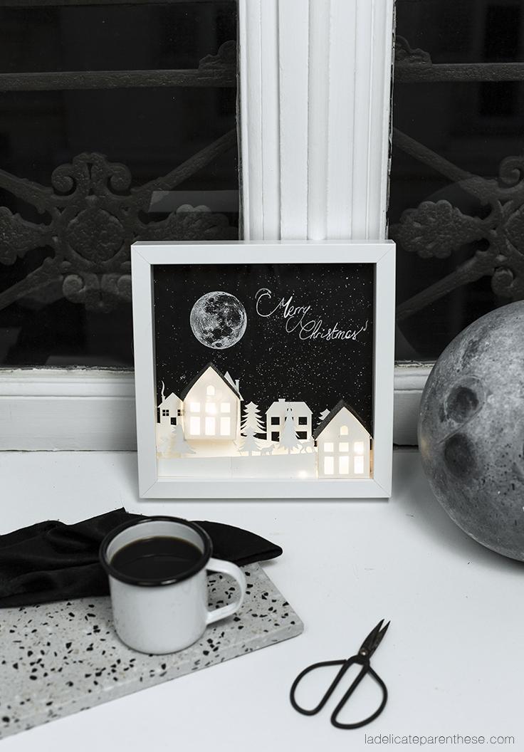 Village lumineux en papier en tableaux