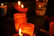Candles inside a Oaxacan church glow brightly