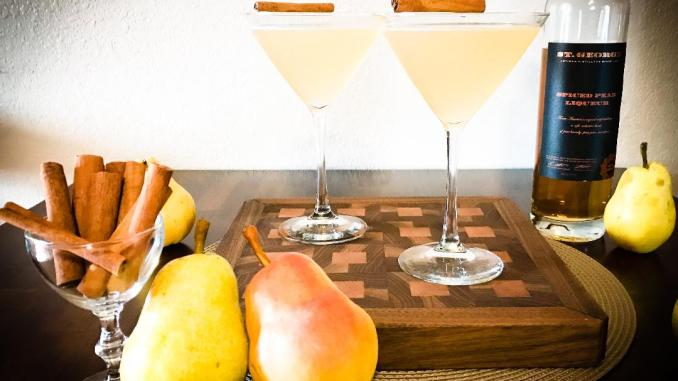 Essence of Fall Martini with ingredients including St. George Spiced Pear Liqueur, Vodka, Lemon Juice, and Simple Syrup.