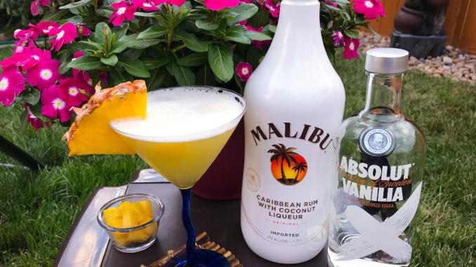 The Pina Colada Martini made with Absolut Vanilla Vodka, Malibu Coconut Rum, Pineapple Juice, Simple Syrup, and fresh pineapple for garnish.