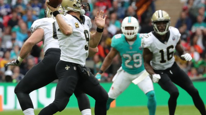 NFL New Orleans Saints quarterback Drew Brees getting ready to throw a pass against the Miami Dolphins.