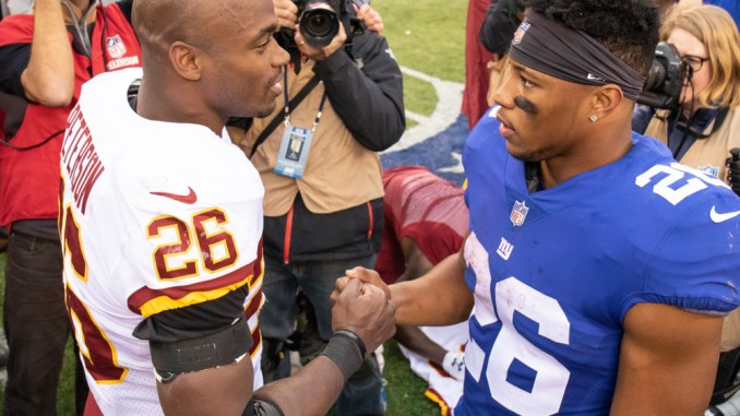 New York Giants running back Saquon Barkley and Washington Redskins running back Adrian Peterson shaking hands after a football game