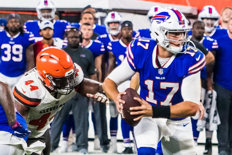 NFL Buffalo Bills quarterback Josh Allen avoiding a sack against the Cleveland Browns defense