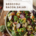 A quick & easy crunchy Broccoli Bacon Salad loaded with red grapes, sweet craisins, sliced almonds, shredded cheddar cheese, diced red onions & creamy homemade dressing.