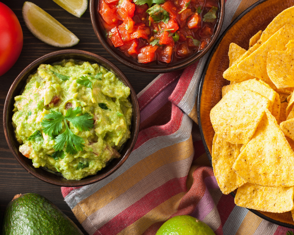 Green Chile & Tequila Guacamole served with corn tortilla chips and fresh salsa.